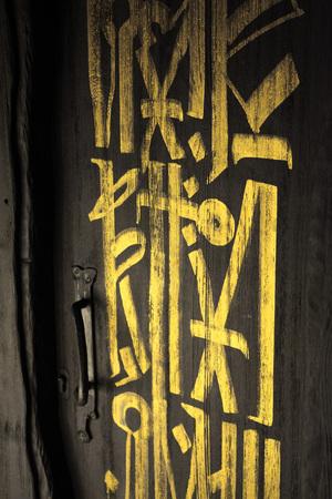 Dark grey door or black door with golden letters on it