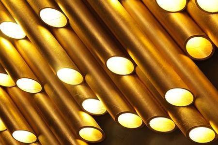 Golden tube lamp. texture closeup 免版税图像