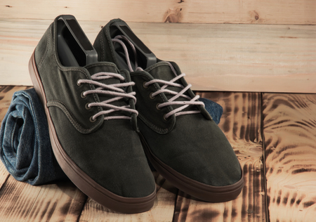 FAshion dark green sneakers and jeans clsoeup.