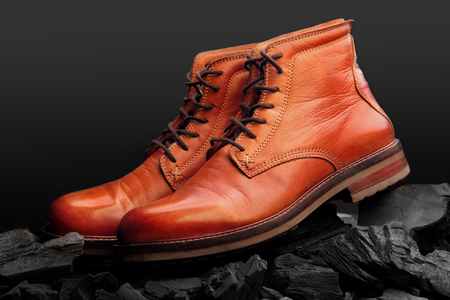 brown leather boots polish.Waxing boots.On charcoal.travel boot
