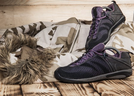 Hiking shoes with camufliage coat and old textures.