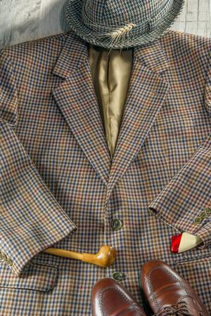 Londoners acessories - hat . tweed jacket, smoking pipe pasportlighter