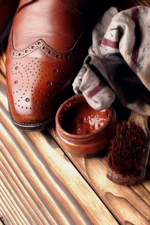 leather shoes brogues with shoe maintenance set.Selective focus.closeup