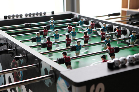 Table football game, Soccer table with red and blue players. Stock Photo