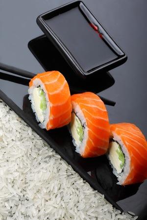 Philadelphia roll sushi with salmon, prawn, avocado, cream cheese. Sushi menu. Japanese food. copy space 免版税图像