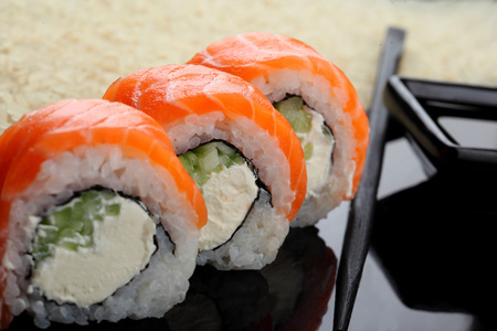 Philadelphia roll sushi with salmon, prawn, avocado, cream cheese. Sushi menu. Japanese food Closeup