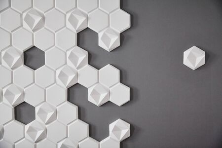 wall background. background texture. wall with textured hexagons. the honeycomb on the wall. gray wall.