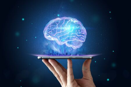 The image of the human brain, a hologram, a dark background. The concept of artificial intelligence, neural networks, robotization, machine learning. copy space.