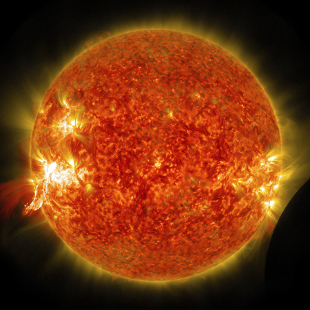 Eruption of a solar flare and a lunar transit captured by NASA's Solar Dynamics Observatory (SDO) on Jan 30th, 2014. This image furnished by NASA Stock Photo - 135438799