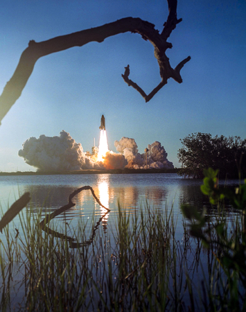 Space shuttle Atlantis and its four-member STS-135 crew head toward Earth orbit and rendezvous with the International Space Station, 8 July 2011. This image furnished by NASA Archivio Fotografico - 136263399