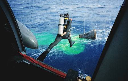 A Navy frogman leaps from a recovery helicopter into the water to assist in the Gemini-12 recovery operations. Original from NASA . Digitally enhanced by rawpixel. Sajtókép