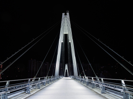 Cable-stayed pedestrian bridge in the night
