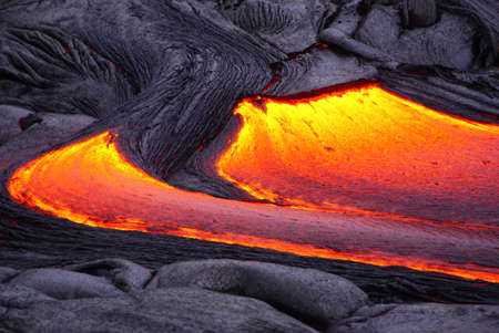 Hot magma of an active lava flow over old lava field, the lava cools slowly and solidifies, Kilauea, Big Island, Hawaii