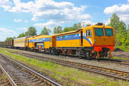 18.06.2017. Russia. Strugi-Krasnyye. yellow recovery train on the railroad. Dynamic tamping Express. Repair the yellow train.