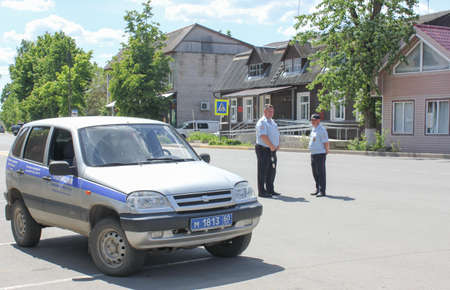 traffic warden: 17.06.2017. Russia, Strugi-Krasnyye. The police blocked the road. Police car in the town square, patrolling the road. Editorial
