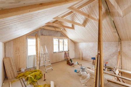 glasswool: the interior of the frame house in process of construction Stock Photo