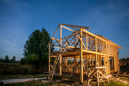 the construction of a village house surrounded by nature Stock Photo