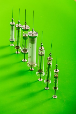 veterinary syringes on a green background