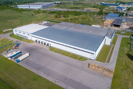 aerial view warehouse building on a summer day Standard-Bild