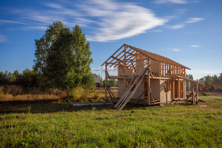 construction of a frame wooden house in the nature
