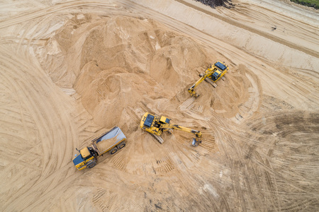 loading sand excavator in a dump truck on the construction site Imagens - 116860334