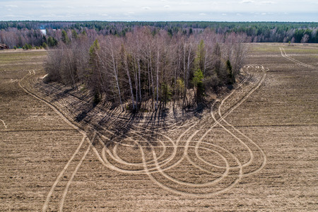 the plowed field, the woods, the view from the drone, the patterns on the field Stok Fotoğraf