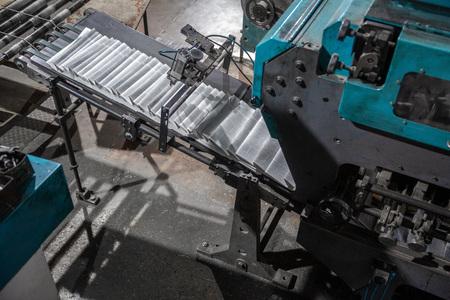 newspaper printing equipment in a dark room