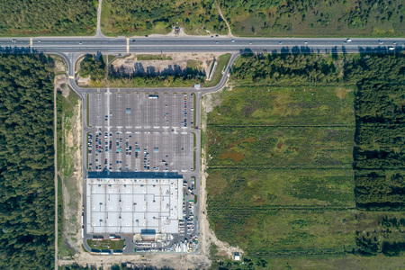 top view of a large shopping center near the highway aerial Stok Fotoğraf