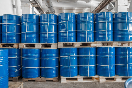 blue barrels in the warehouse on wooden pallets