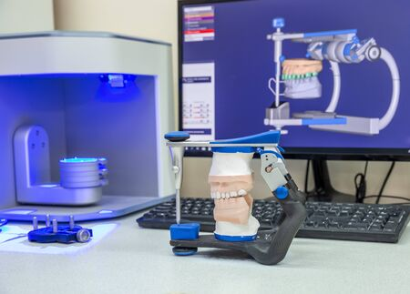 3D scanner and PC in the process of creating dentures Фото со стока