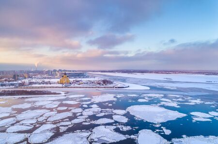 Spring ice drift in Nizhny Novgorod, on Strelka, the confluence of the Oka and Volga. Shooting from a height