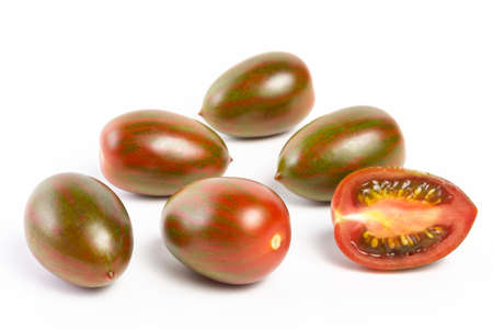 a few tomatoes on a white background with a shadow. Stock Photo