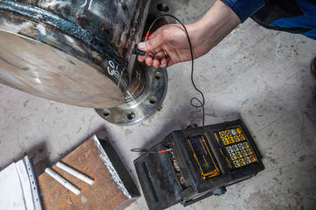 check the quality of the weld with an ultrasonic device. Metalworking production