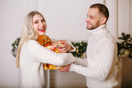 daugther: couple giving  present to each other happy