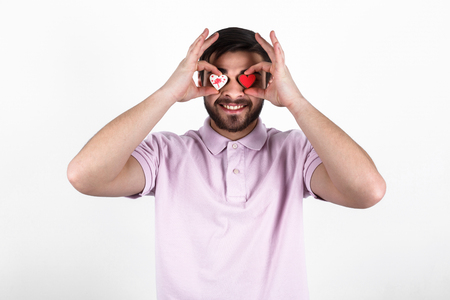 smilling: valentine romantic man holding candy hearts and smilling Stock Photo