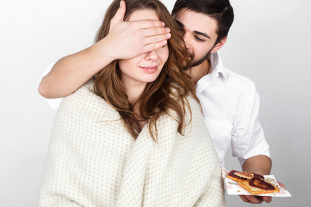 girl in love: Happy family couple eating breakfest on valentines day