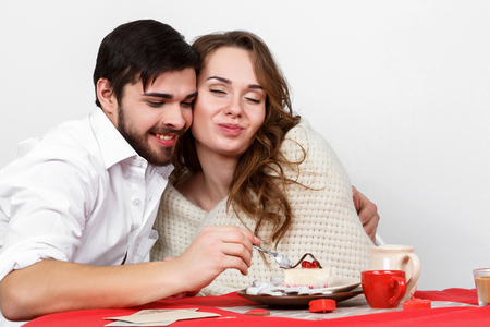 emotional love: Happy family couple eating breakfest on valentines day