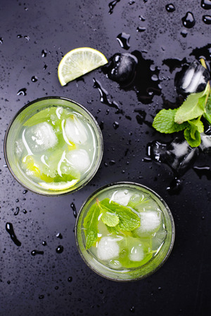 Tasty mojito coctail with lime on the table Stock Photo