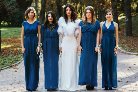 bridesmaid: Bride with bridesmaid standing straight in the park Stock Photo