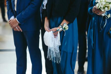 usher: Bridesmade holds white lace shawl Stock Photo