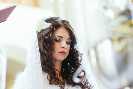 Bride with closed eyes during the ceremony