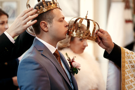 earing: Beautiful newlyweds on wedding ceremony in the church