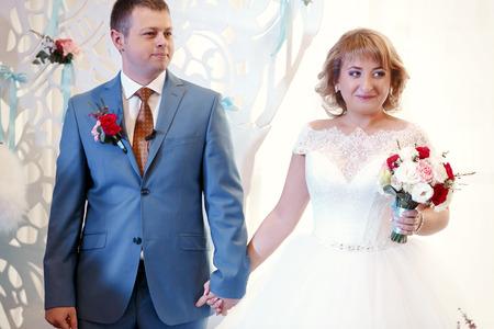earing: Happy beautiful newlyweds in restaurant