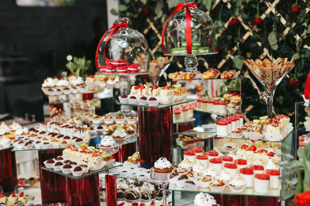 Amazing Sweet Buffet With Dishes Put On Red Vases Stock Photo