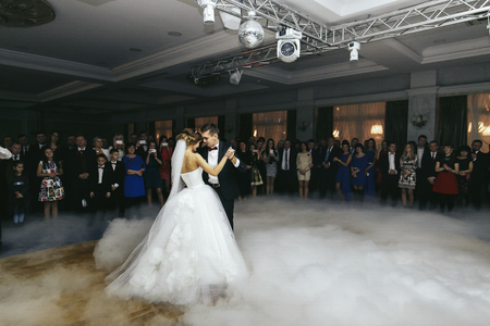 butonniere: Thick smoke enveloped newlyweds Stock Photo