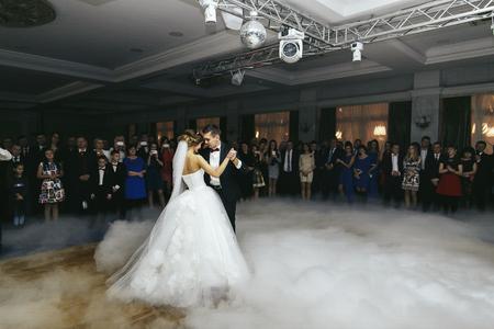 enveloped: Thick smoke enveloped newlyweds Stock Photo