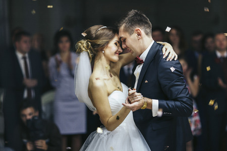 Just married looks romantically while dancing