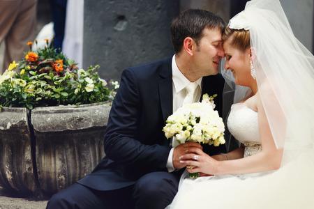 lifelong: A lifelong moment - groom kisses brides forehead