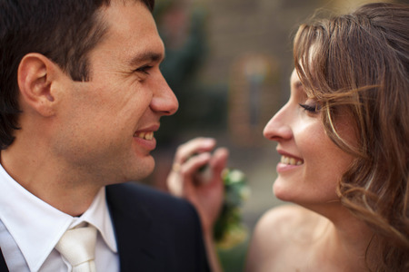 Man looks at the smiling woman with brown hair