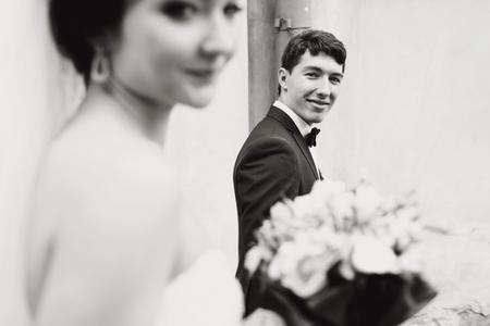 tenderly: Groom looks tenderly at the sad bride